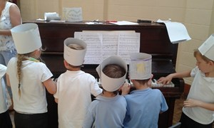 Exploring the piano at Llanelwedd Primary School