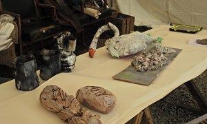 Papier mache swan, loaves, fish and tankards for the banquet scene